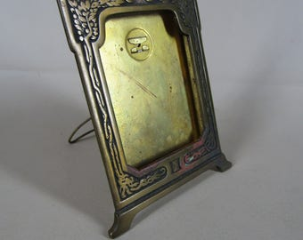 Antique bronze picture frame arts and crafts trees