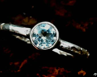 Sky Blue Topaz set in etched silver ring.