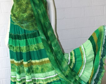 A green set from silk: skirt, tunic, shawl and beads