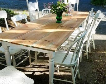 Lovely farm table with mismatched chairs