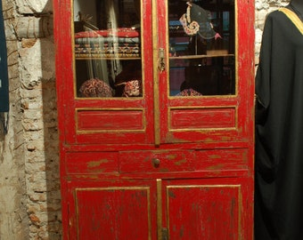 Vintage Red Showcase, Indonesia. Display cabinet with compartments.