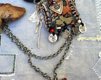 Medicine necklace, talismans, amulets, tribal, ethnic, black-taupe-rust-silver. Velvet, wool, gunmetal chains, horn, silver plated