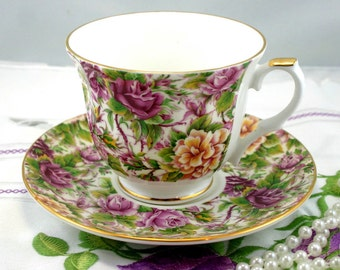 Elite, Chintz Pattern Teacup & Saucer, Gold Rims, Bone China made in England in 1950s.