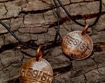 Resist penny pendant