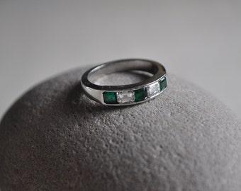 Platinum diamond and emerald eternity ring