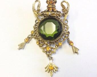 Vintage, orange and green rhinestone brooch signed Dorene. AF. Vintage statement brooch.