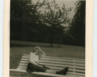 Vintage photo 'Surreal school girl' - vernacular photography snapshot - cinematic atmosphere, park, bench, noir