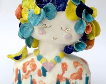 Ceramic lady with yellow bird