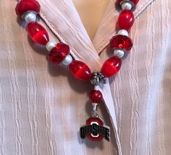 Ohio State Buckeyes Beaded Necklace with Enameled Color Logo. Various Red Beads and White Pearls. Silver Chain. Lava Bead Diffuser Option.