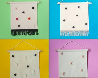 Mini pom pom and fringed wall hanging banner