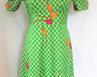 Vintage bright green floral dress, size 10 from the 1970's with trellis pattern and orange and red roses. Very Wizard of Oz! Handmade