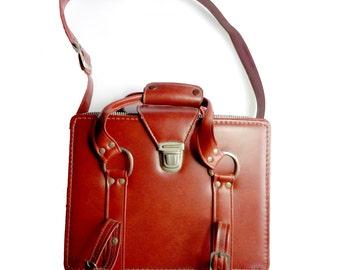 Vintage brown tan camera equipment bag or satchel with foam padding inside