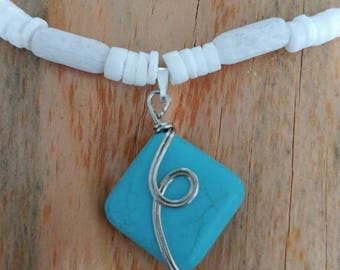Turquoise Blue pendant on chain of stone beads and glass beads.