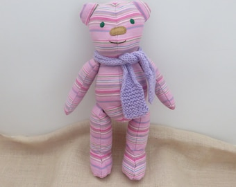 Catalina. The cute, cuddly, pink stripe material, soft, handmade Teddy Bear with a purple wool scarf.