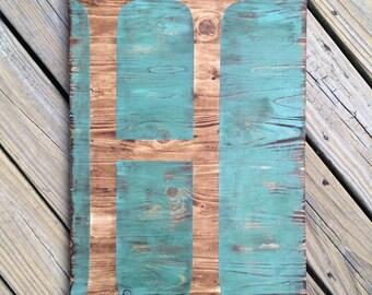 Single letter wood sign