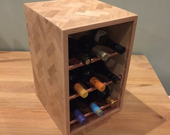 Wine rack in an industrial style with copper pipe racking and reclaimed oak herringbone inlay case