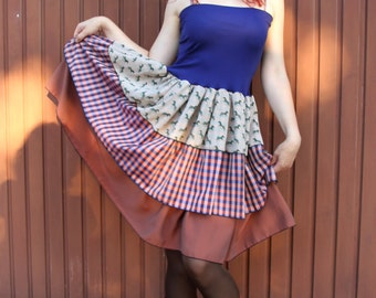 Playful tiered skirt with Plaid and Zebra in shades of Brown and blue