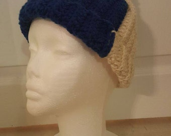 blue and white winter hat with pom pom
