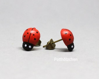 Wooden ear plug ladybugs - red black