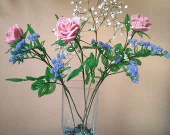 Bouquet of pink roses, gypsophila and blue statice