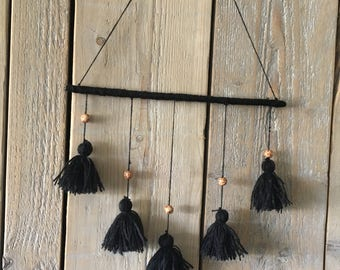 Black pendant with tassels and wooden beads