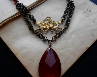 treason - lion and crossed sword repurposed found object jewelry ruby red crystal necklace lannister lion bib necklace statement necklace