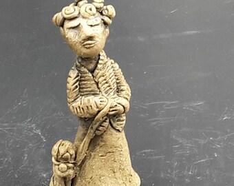 the dog walker - stoneware original sculpture
