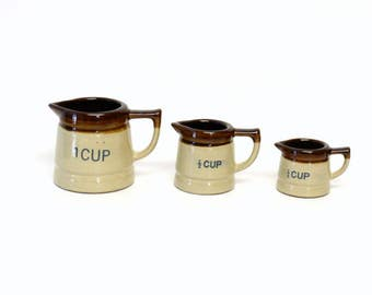 Set of Three Brownware Ceramic Measuring Cups with Handles