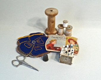 Vintage Sewing, sterling thimble, wood spools, decorative scissors, antique pin cube with glass head pins, 2 needle books