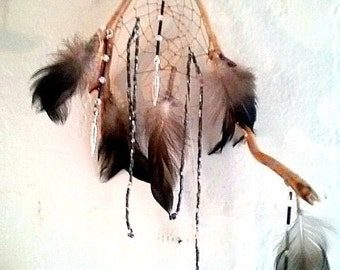 Duck Feather Dreamcatcher on natural wood