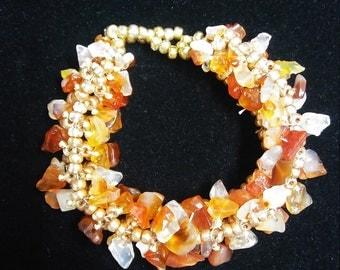 Gold beaded bracelet embellished with real polished amber chips.