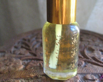 Arabesque Aromas botanical perfumes - available in a 6 ml size; gold-painted Moroccan glass bottles