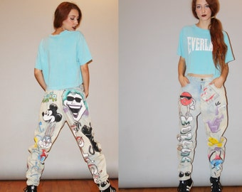 RARE 1990s Airbrushed Hip Hop Rap Rapper Comic Book Graphic Mickey Mouse Joker Acid Wash Chemical Wash Denim High Waist Jeans  - W00004