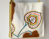 CLEARANCE SALE! 4 sided hair on cowhide purse in light brown and white with colorful textile leaf applique