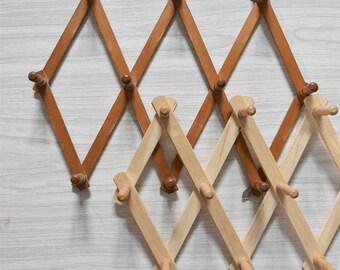 vintage light colored wood accordion wood peg wall hanging rack // hat display storage // organizer