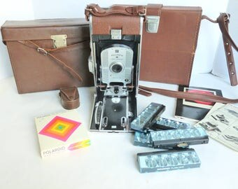 Polaroid Land Camera Photography Lot Model 95 with Exposure Meter, Film, Flash Bars, SX-70 Accessories and Carrying Cases