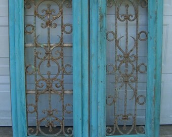 antique pediment windows with iron panels;salvage windows,chippy blue,hand carved window panels,architectural windows,decorative wall art