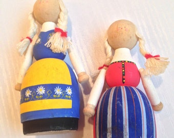 A Charming Pair of Vintage Swedish Wooden Souvenir Dolls