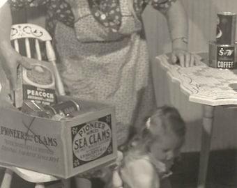"Vintage Snapshot ""Helping Grandma Put Away The Groceries"" Cute Little Girl Pancake Mix Kitchen Table Apron Found Vernacular Photo"