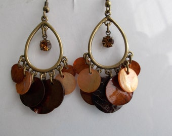 Bronze Tone Teardrop Chandelier Earrings with Brown Shell Disc Bead Dangles and a Brown Crystal Like Bead Center