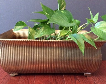 large brass footed planter / Hollywood Regency