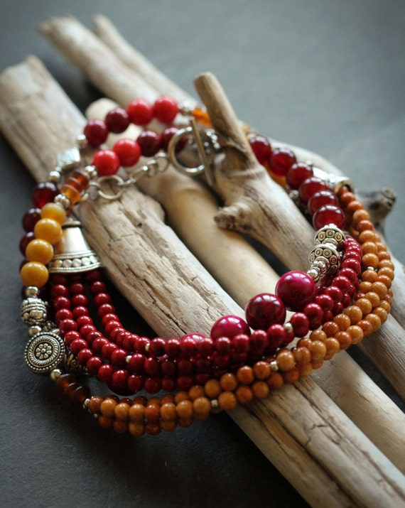 Necklace Kesa: fossil stone, amber, glass, silver color, yellow, red, stainless steel