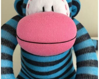 Bright and cheerful Stripy  Sock Monkey