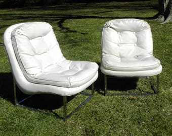 Vintage Mid Century Modern White Vinyl and Chrome Slipper Chairs --- 395.00 for the pair.