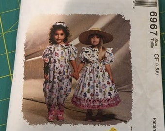 McCall's pattern #6957 Girls Sizes 4, 5, 6 Mousefeather's Dress & Jumpsuit
