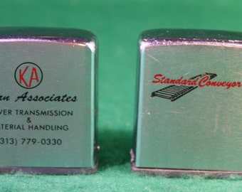 Pair of vintage Zippo advertising tape measures