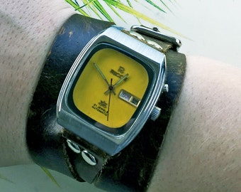 Vintage 1950s Ricoh watch with a handmade wrap around leather band