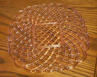 Pink glass platter, basket weave,  squarish.