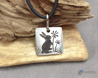 Bunny rabbit and flowers silhouette pendant in carved fine silver, sterling silver bail . Rabbit necklace . Bunny silhouette necklace