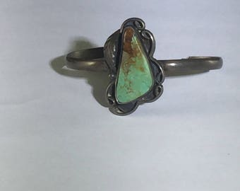 Southwestern Turquoise Silver Cuff with Large Asymmetrical Green Turquoise Stone with Gold Brown Veins on a Thin Sterling Silver Cuff